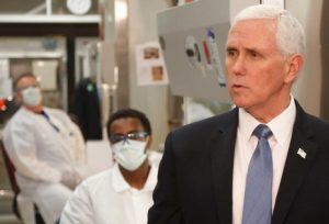 Pence wears no mask at COVID-19 clinic